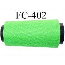 Cone de fil  polyester  fil n°120 couleur vert fluo longueur du cone 2000 mètres bobiné en France