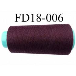 Cone ( en Destockage ) de fil  polyester  fil n°35 couleur bordeau prune foncé longueur du cone 2000 mètres bobiné en France